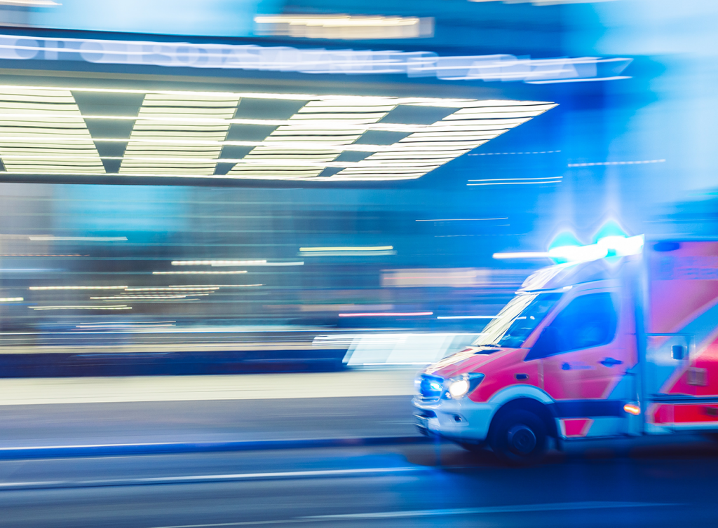 european ambulance driving with emergency lights on